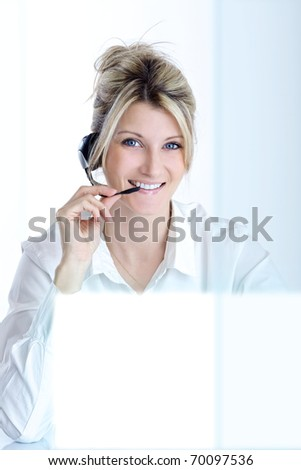 blond girl with headphones - stock photo