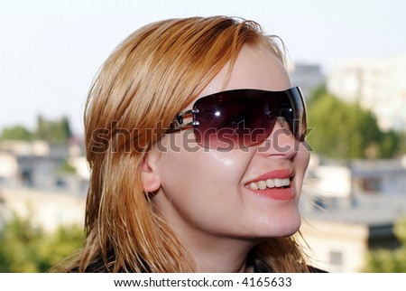 blond girl with sunglasses smiling