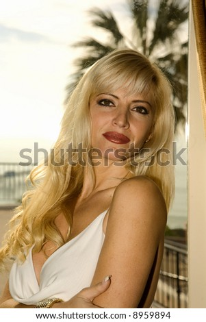 Blond Glamorous Woman looking at the camera. - stock photo