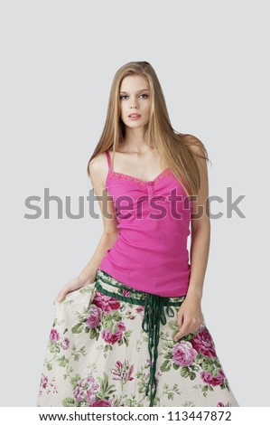 blond hair female fashion model posing at light grey background - stock photo