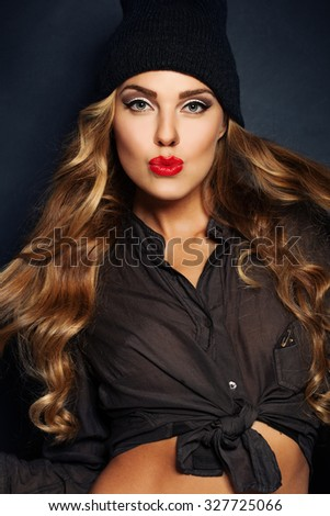 Blond Hair Girl. Makeup and Curly Hairstyle. Beauty Fashion Portrait - stock photo