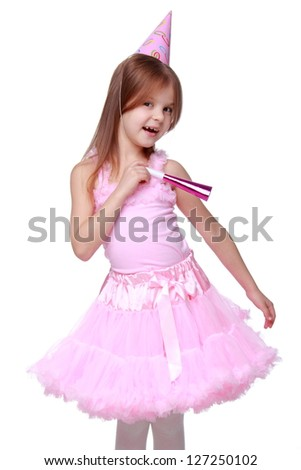 Blond hair young girl is posing on birthday party