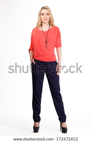 Blond haired business woman in red blouse isolated on white