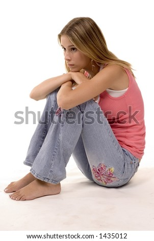 blond in studio sitting and thinking - stock photo