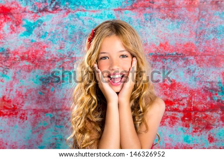 Blond kid girl happy smiling expression hands in face gesture - stock photo