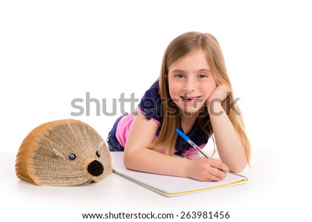 Blond kid girl student with hedgehog book on white background - stock photo