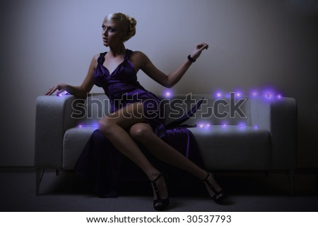 blond lady in violet dress - stock photo