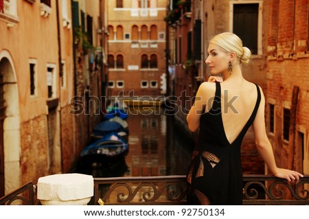 Blond lady on a bridge. - stock photo
