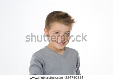 blond little boy smiles to camera - stock photo