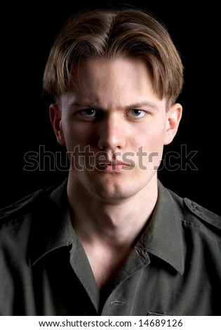 blond man in khaki shirt on black - stock photo