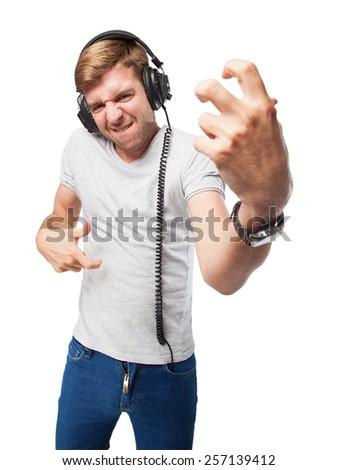 blond man with headphones - stock photo
