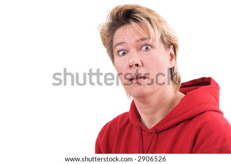 Blond mature woman looking totally shocked with big eyes - stock photo