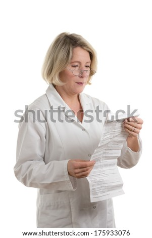 Blond pharmacist with glasses reading package insert, isolated, copy space - stock photo