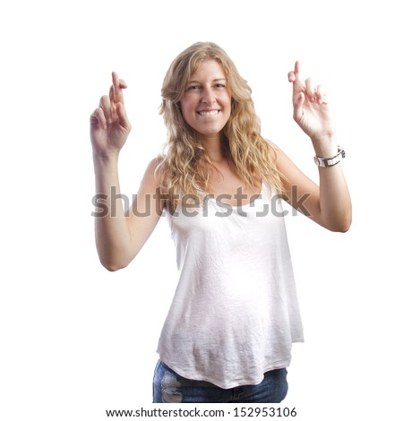 blond pretty woman with finger cross gesture - stock photo