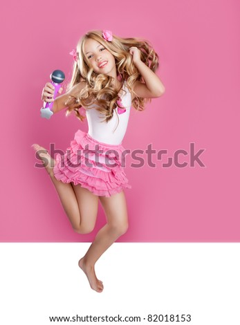 blond singer star girl like fashion doll with mic jumping high - stock photo