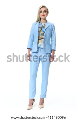 blond slavic business executive woman with straight hair style in summer denim blue suit jacket trousers high  heel shoes going full body length isolated on white - stock photo