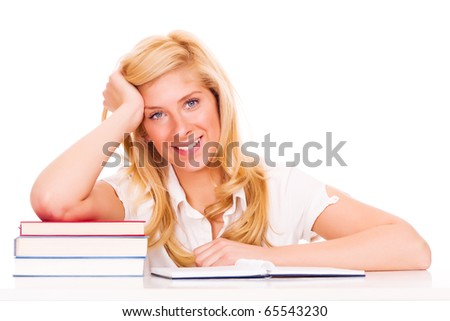 Blond student with books at the table, isolated on white