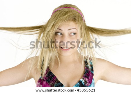 Blond teenage girl wearing a print dress with long stringy hair against a white background - stock photo