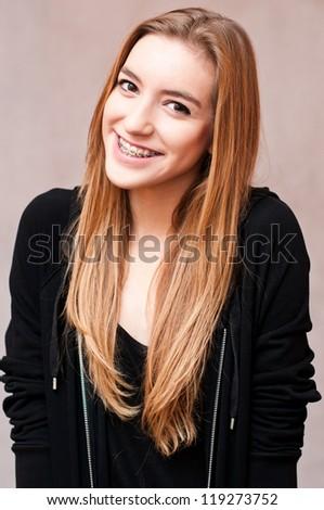 blond teenage girl wearing braces - stock photo