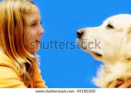 blond teenager girl with her golden retriever dog - stock photo