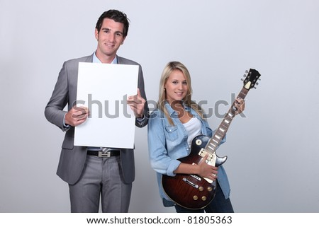 Blond teenager guitar lesson - stock photo