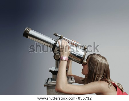 Blond teenager watching the sky through a telescope. - stock photo