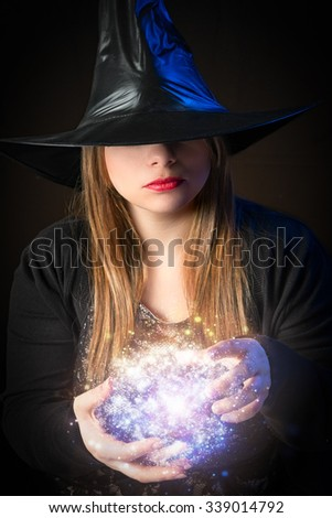 blond witch does magic with his hands  - stock photo