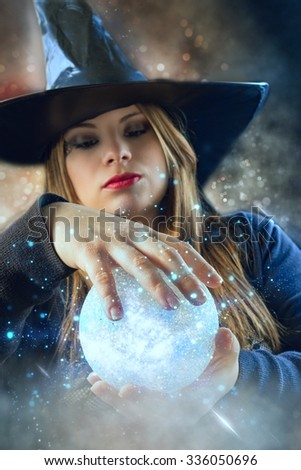blond witch with magic ball - stock photo