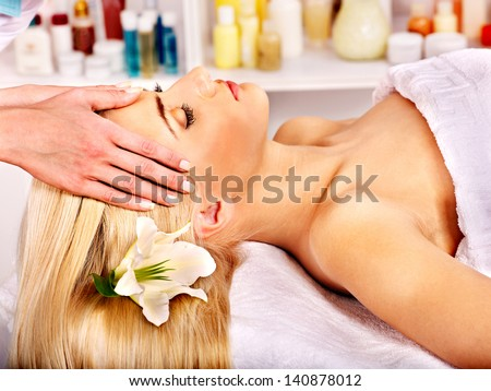 Blond woman getting head massage.