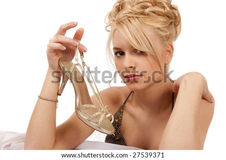 Blond Woman Holding A Gold Shoe - stock photo