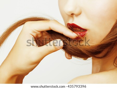 Blond woman holding her long strand in fingers, sexy stylish fashion  concept - stock photo