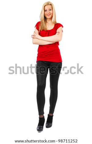 Blond woman in tight pants isolated on white background - stock photo