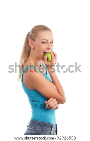 Blond woman looking at a red apple
