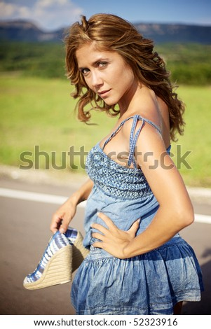 Blond woman on summer day - stock photo