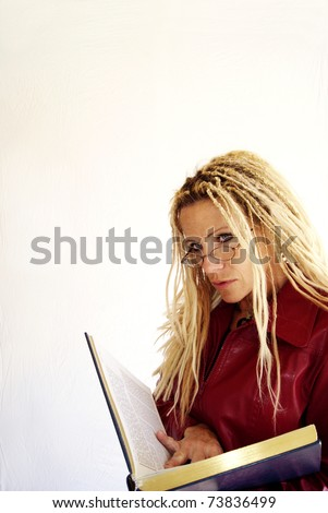 Blond woman reading  book - stock photo