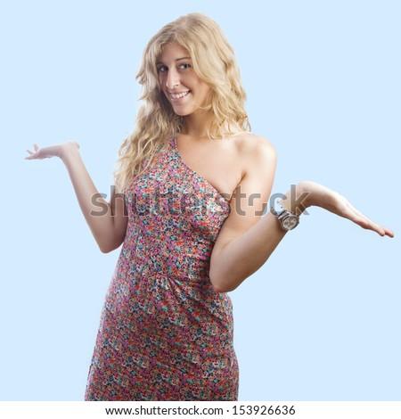 blond woman showing shomething - stock photo