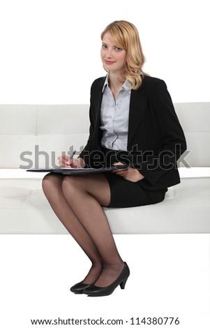 Blond woman taking survey - stock photo