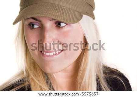 Blond woman wearing a hat looking to the side.