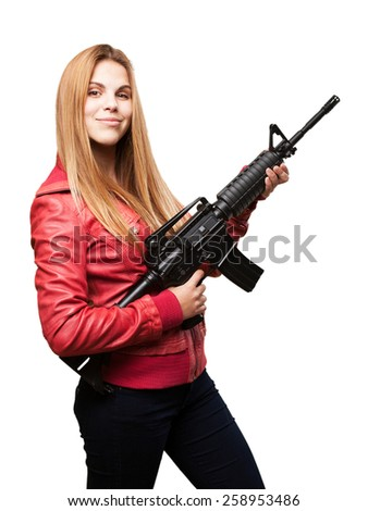 blond woman with a gun - stock photo