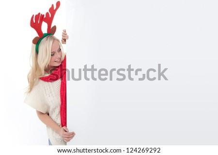 blond woman with antlers with an advertising space, young blond woman disguised as an elk, young blond woman with horns