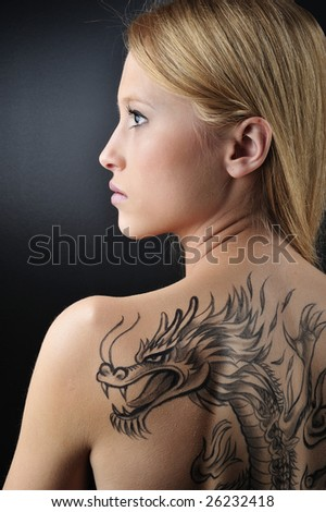 Blond woman with dragon tattoo - stock photo