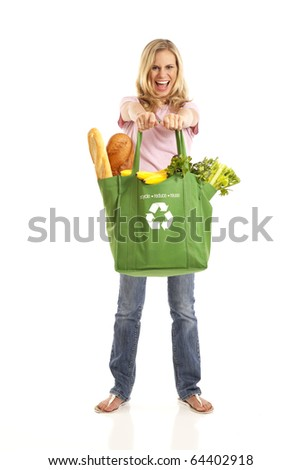 Blond woman with green grocery bag filled with healthy food - stock photo
