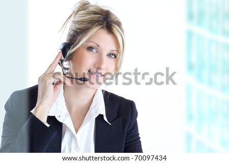 blond woman with headphones - stock photo