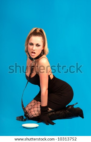 blond woman with leather collar - stock photo