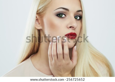 Blond woman with manicure.Beautiful girl model with perfect skin, evening make-up and white color nails.Tender Beauty Girl. Nail design - stock photo