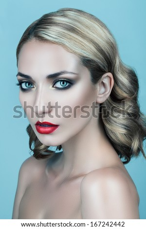 blond woman with red lips and curly hair