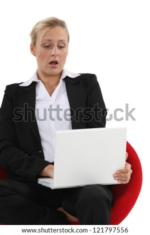 Blond woman with surprised look on her face - stock photo