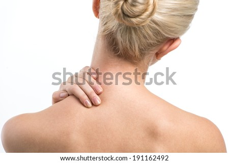 Blond women with neck ache. lond women with neck and backache rubbing area to ease pain - stock photo