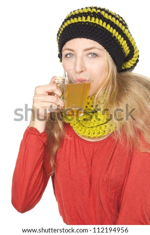 blond young woman with scarf  drinking tea - stock photo