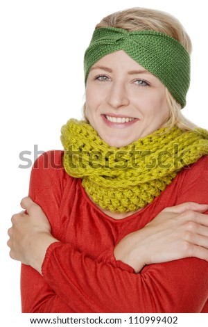 blond young woman with warm wool scarf - stock photo